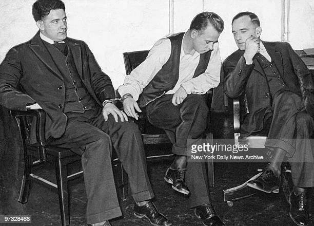 Detective Carrol Holley is handcuffed to notorious outlaw John Dillinger who is conferring with his attorney Joseph Ryan in Crown Point Ind