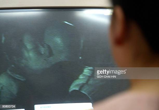 A detective from the Women's Rights Protection Investigation Center shows off a video they shot of a cheating husband with his mistress in Chengdu...