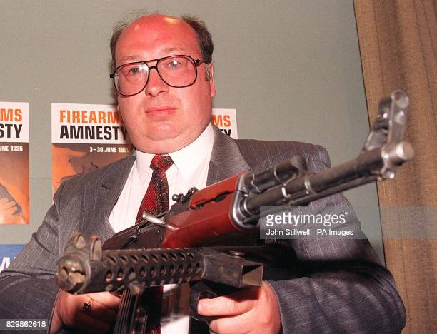 Detective Inspector Peter Turner of the Metropolitan Police with a Kalashnikov assault rifle and a Sterling sub machine gun two of the weapons handed...