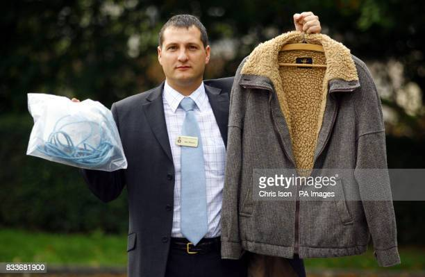 Detective Inspector Sean Memory at Salisbury Police Station in Wiltshire holding a jacket and length of rope owned by Christopher Downes who...