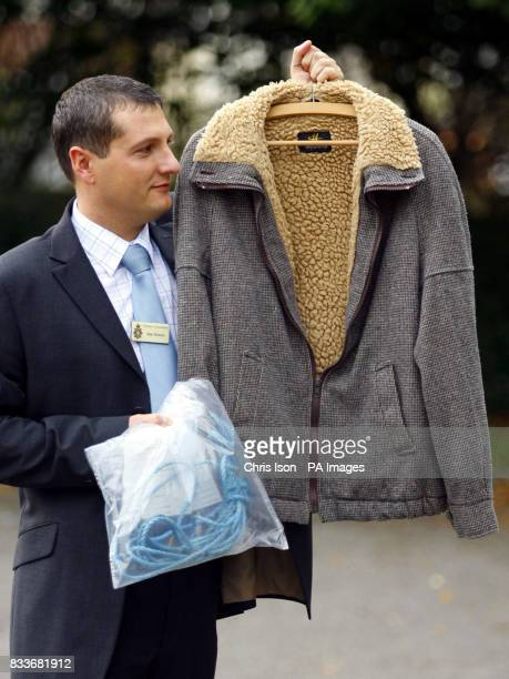 Detective Inspector Sean Memory at Salisbury Police Station in Wiltshire holding rope and a jacket belonging to Christopher Downes who committed...