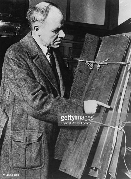A detective investigating the kidnap and murder of 14yearold Robert Franks pointing to what appear to be bloodstains on the floorboards of a car used...