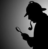 detective seeking clues in the dark
