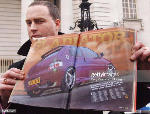 Detective Sgt Tom Andrews holds up a doublepage photo of the Saxo car Wednesday February 22 2006 that belonging to Llewellyn Luce that was printed in...