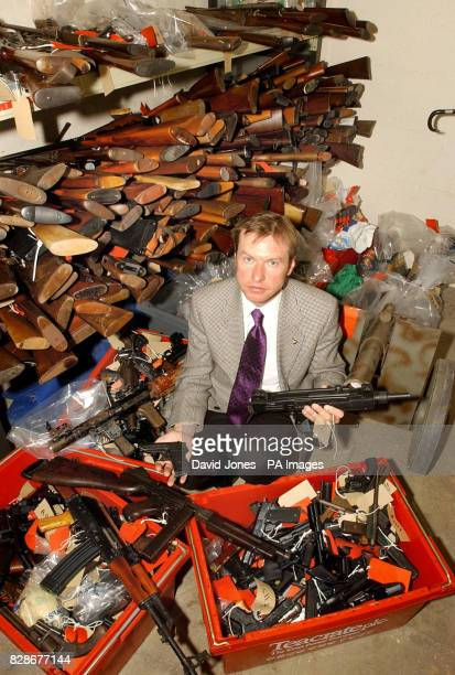 Detective Superintendent John Hesketh of West Midlands Police with some of the more than 800 weapons handed in during this month's gun amnesty The...