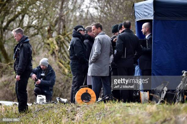 Detective superintendent Pat Campbell watches as Police Scotland divers search a canal stretch for an eleven year old schoolgirl Moira Anderson on...