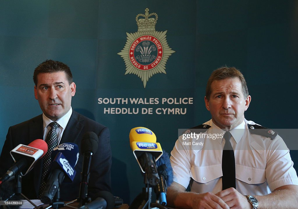 Detective Superintendent Paul Hurley (L) and Superintendent Julian Williams (R) give a press conference on October 20, 2012 in Cardiff, Wales. Detectives are questioning a 31-year-old man arrested on suspicion of murder after a series of hit-and-runs in Cardiff that left a woman dead and 13 people injured. Nine casualties, five of them children, are still in hospital, with two adults in critical but stable conditions.