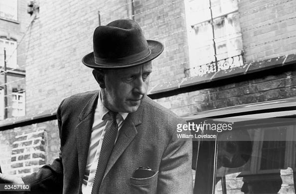 Detective Superintendent Richard Chitty arrives at a West London court with John Edward Witney who was soon to stand trial for the murder of three...