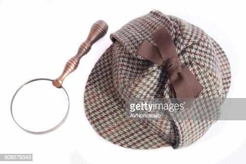 Defassa waterbuck Oder Sherlock Holmes cap und vintage Lupe : Stock-Foto
