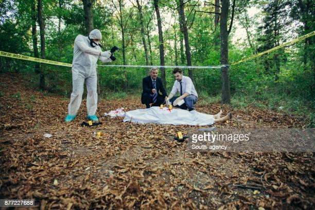 Detectives examining murder crime