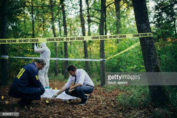 Detectives on a crime scene