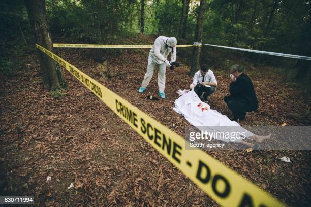 Detectives on murder crime scene