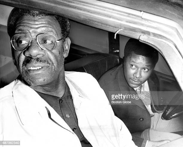 Detectives Thomas Scott left and Courtland Ballard sit in a car while on patrol in Boston on Dec 7 1971 They are both members of the new...