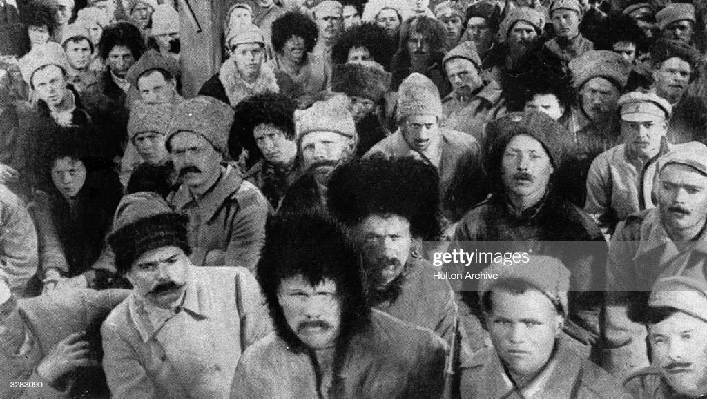 Determination is etched on the faces of the crowd during the Russian Revolution.