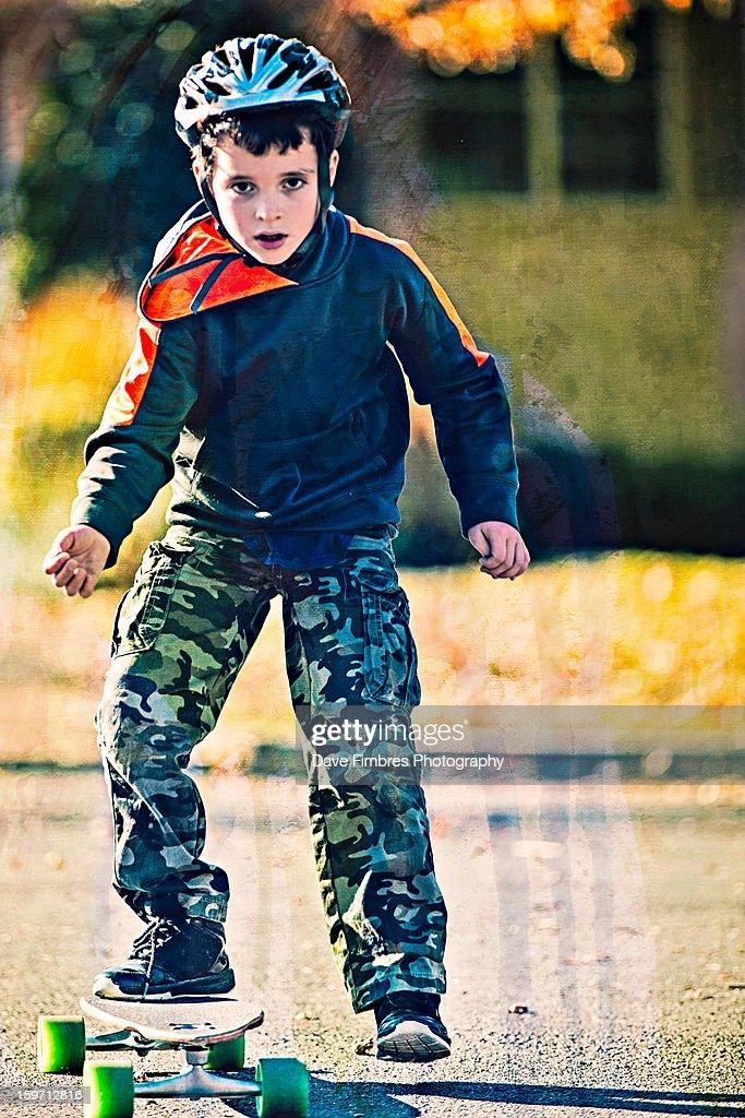 Determined Boy On A Skateboard : Stock Photo