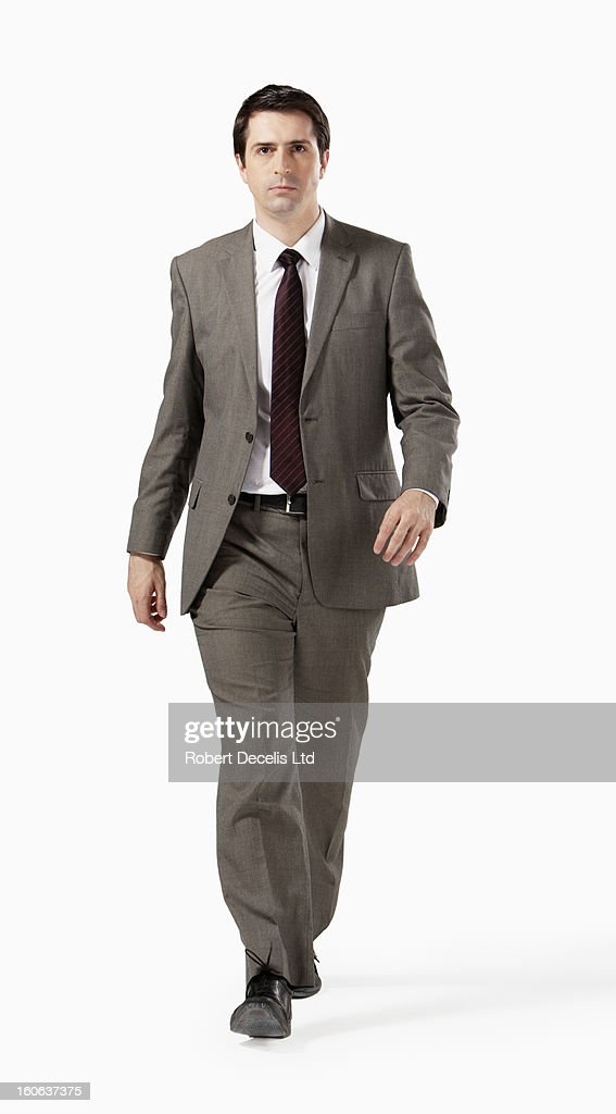 Determined business man walking towards camera