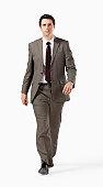Determined business man walking towards camera