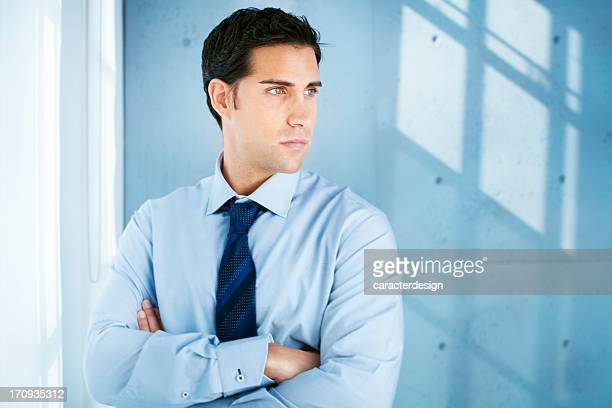 Determined businessman in a concrete office