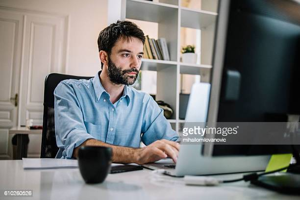 Determined businessman working on his computer