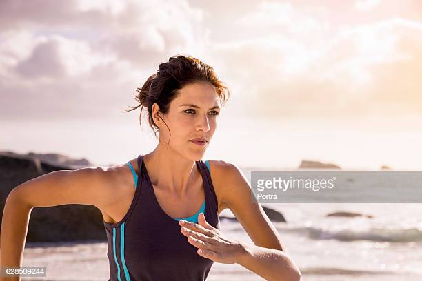 Determined female athlete jogging at beach
