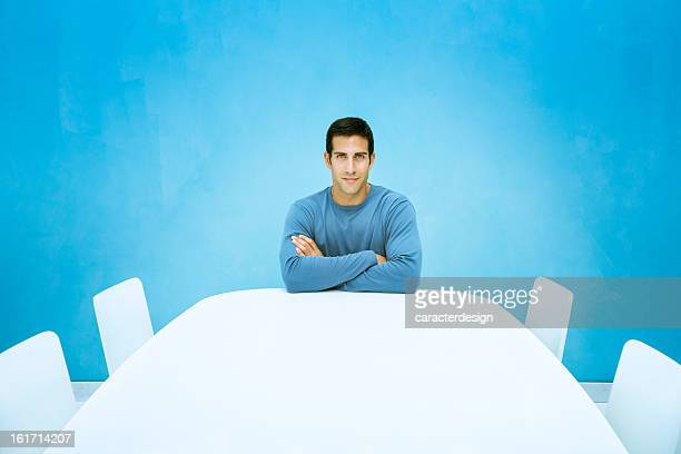 Determined man in empty board room