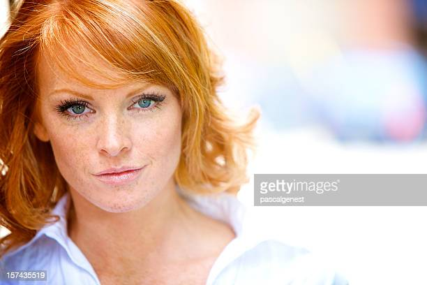 determined red hair woman portrait