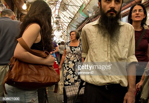 determined shopper rushes through market : Stock Photo