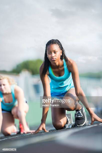 Determined Student Athlete at Starting Block of Race