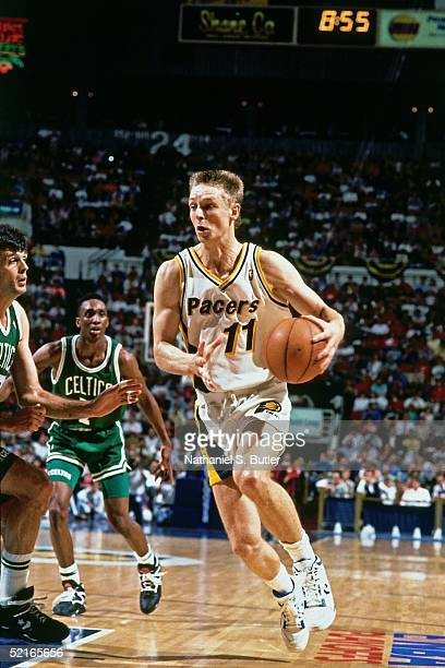 Detlef Schrempf of the Indiana Pacers drives to the basket against the Boston Celtics during an NBA game at Market Square Arena circa 1990 in...