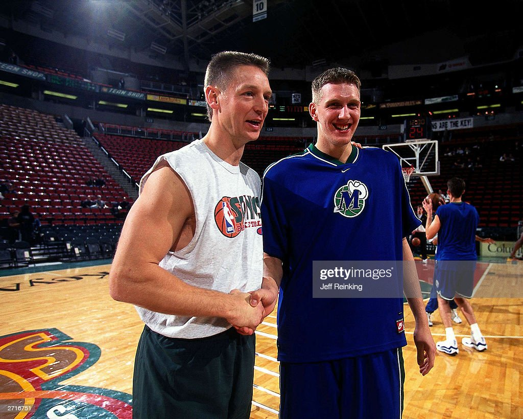 Detlef Schrempf and Dirk Nowitzki shake hands prior to their game