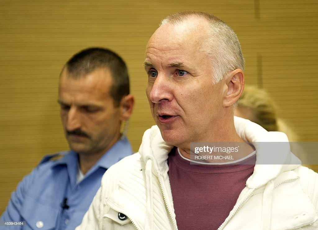 Detlev Guenzel (R), a 56-year-old German police officer, arrives for the ...