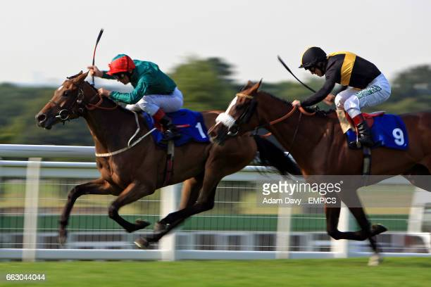 Detonator ridden by jockey Frankie Dettori leads from eventual winner Victoria Montoya ridden by jockey Francis Norton during The Golden Link...
