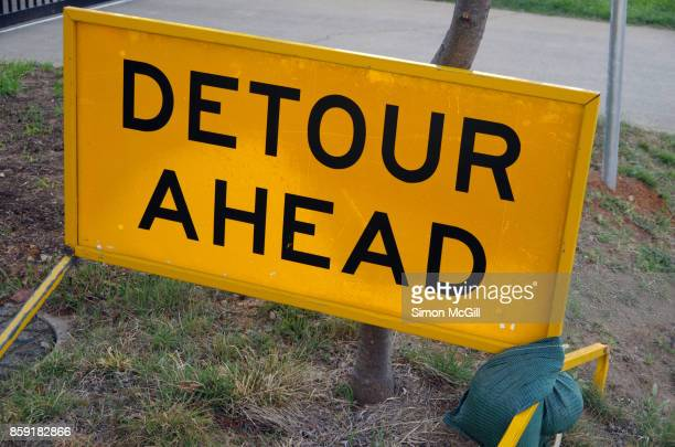 'Detour Ahead' sign on the side of a road