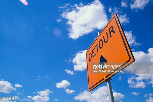 Detour Sign Against Clear Sky