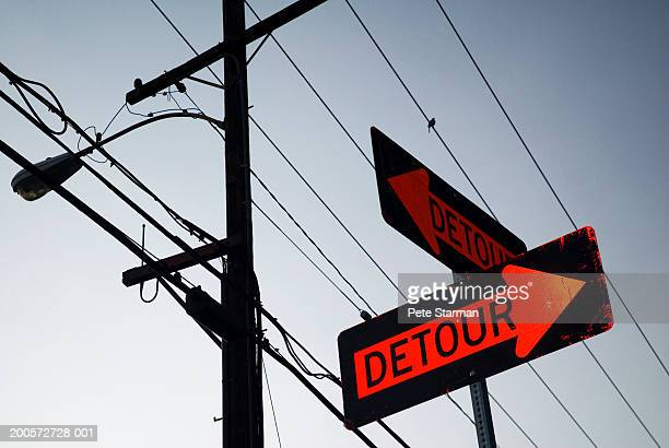 Detour sign and utility pole, low angle view