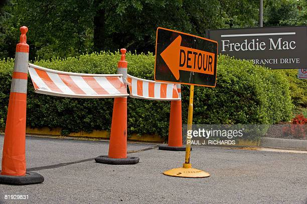 A 'detour' sign is posted at the main entrance to the Freddie Mac headquarters on July 14 2008 in McLean Virginia Fannie Mae and Freddie Mac stocks...