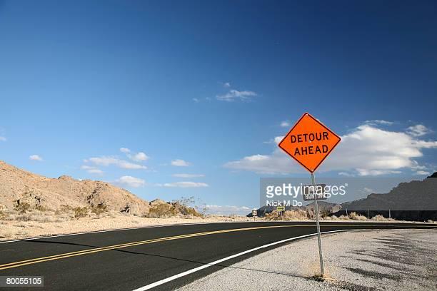 Detour sign on open road