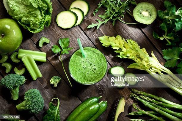 Detox diet concept: green vegetables on wooden table