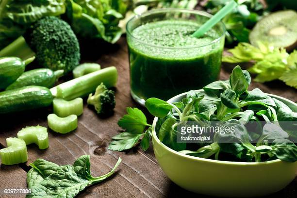 Detox diet concept: green vegetables on wooden table