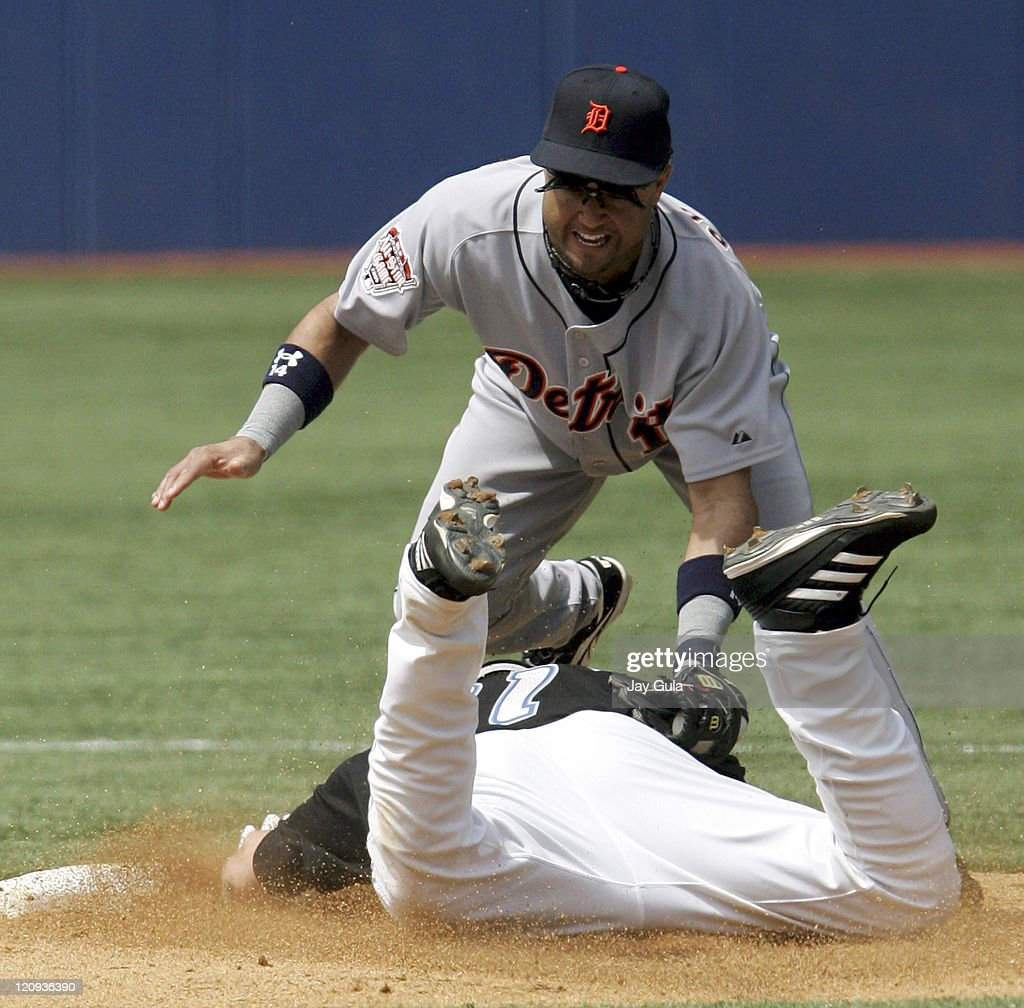 Detroit 2nd baseman Placido Polanco tags out a sliding Eric Hinske at 2nd base in the Detroit Tigers vs Toronto Blue Jays game in Toronto Canada on...