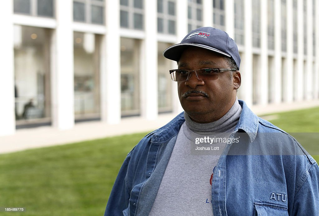 Detroit Department of Transportation worker Schetrone Collier, who has been employed for 25 years, poses for a portrait as he participates in a sick-out protest outside the Coleman A. Young Municipal Center, the headquarters for Detroit's Mayor Dave Bing and Emergency Manager Kevyn Orr October 21, 2013 in Detroit, Michigan. Collier was beaten by two passengers in 2011.The city bus drivers are demanding better protection from Detroit Police Officers as drivers continue to get physically and verbally assaulted by passengers.