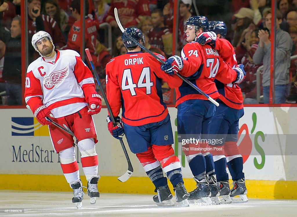 Detroit left wing <a gi-track='captionPersonalityLinkClicked' href=/galleries/search?phrase=Henrik+Zetterberg&family=editorial&specificpeople=201520 ng-click='$event.stopPropagation()'>Henrik Zetterberg</a> (40), left, reacts to Washington defenseman <a gi-track='captionPersonalityLinkClicked' href=/galleries/search?phrase=John+Carlson+-+Ice+Hockey+Player&family=editorial&specificpeople=7983228 ng-click='$event.stopPropagation()'>John Carlson</a> (74) 2nd half goal as the Detroit Red Wings play the Washington Capitals at the Verizon Center in Washington DC, January 10, 2014
