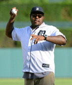 Detroit Lions defensive tackle Nick Fairley throws out the ceremonial first pitch prior to the game between the Detroit Tigers and the Toronto Blue...