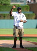 Detroit Lions defensive tackle Nick Fairley waves to the crowd before throwing out the ceremonial first pitch prior to the game between the Detroit...