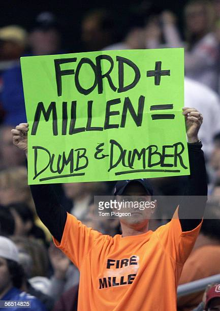 Detroit Lions fan displays a sign that reads 'Ford Millen = Dumb Dumber' to express his displeasure with the lions front office during the NFL game...