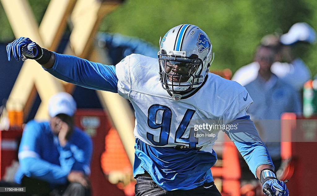 Detroit Lions first round draft pick Ezekiel Ansah #94 goes through the morning drills during training camp on July 30, 2013 in Allen Park, Michigan.