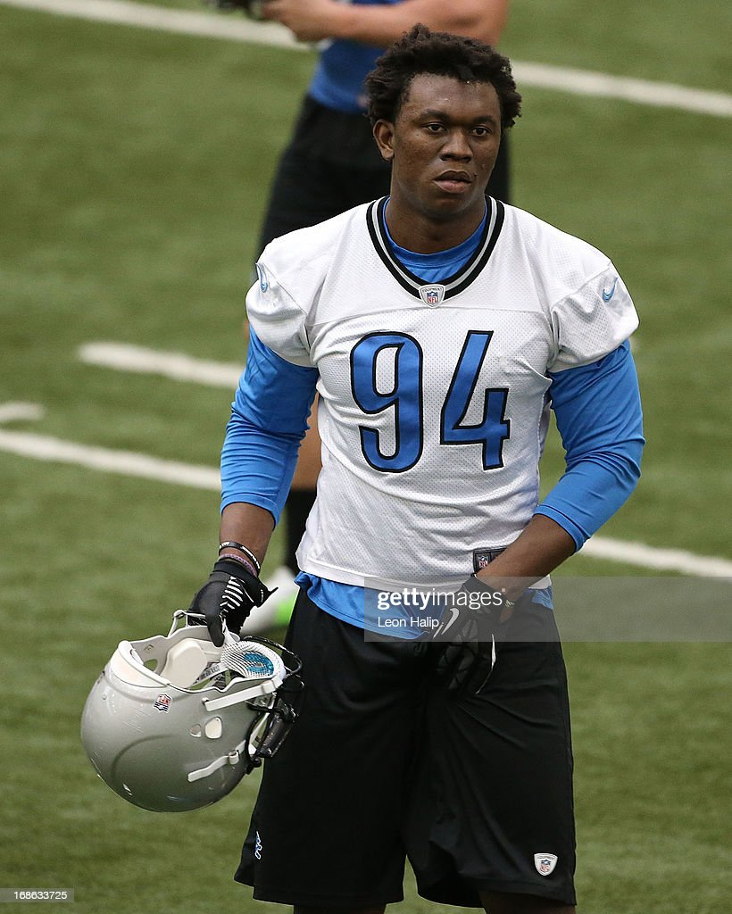 Detroit Lions first round draft pick Ezekiel Ansah #94 warms up prior to the start the morning drills during the second day of Rookie Camp on May 11, 2013 in Allen Park, Michigan.