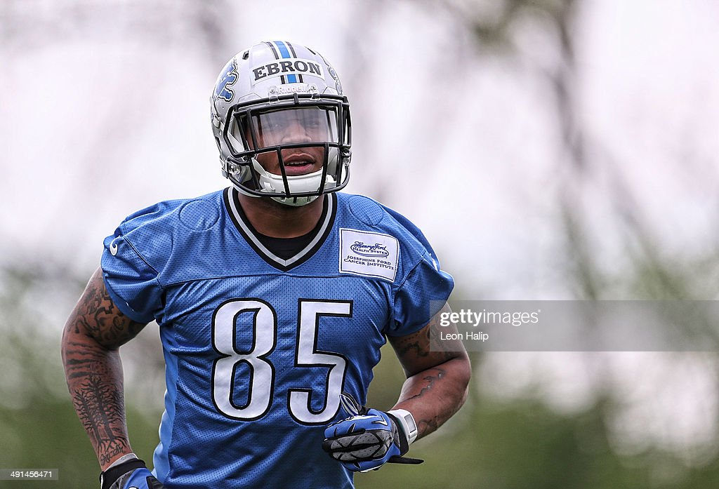 Detroit Lions first round NFL Draft pick <a gi-track='captionPersonalityLinkClicked' href=/galleries/search?phrase=Eric+Ebron&family=editorial&specificpeople=8312199 ng-click='$event.stopPropagation()'>Eric Ebron</a> #85 goes through the passing drills during Detroit Lions Rookie Minicamp on May 16, 2014 in Allen Park, Michigan.
