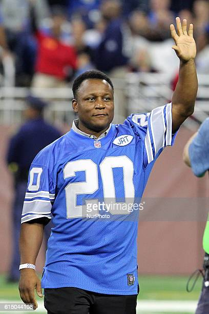 Detroit Lions former Barry Sanders RB greets the crowd while being honored along with other former 1991 teammates during halftime of an NFL football...