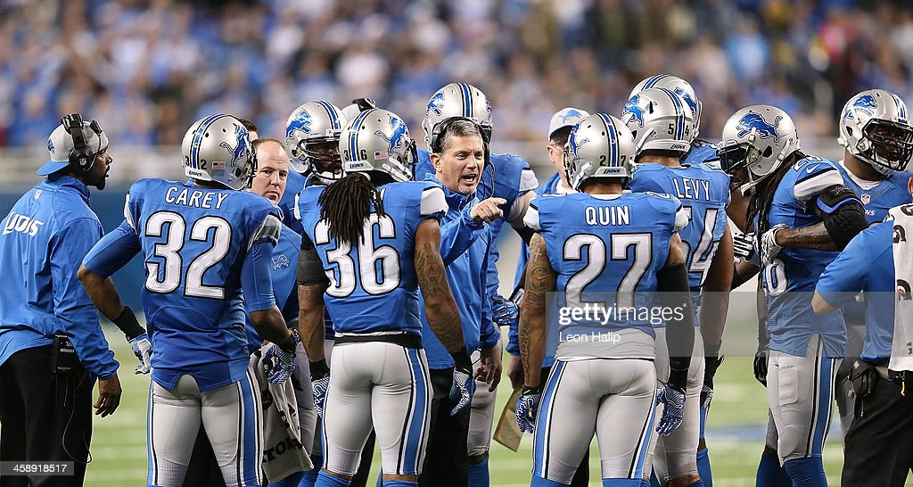 Detroit Lions head coach Jim Schwartz gives instructions during the overtime period of the game against the New York Giants at Ford Field on December 22, 2013 in Detroit, Michigan. The Giants defeated the Lions 23-20.